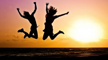 young-people-jumping-in-sunset